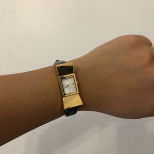 Gold bow watch